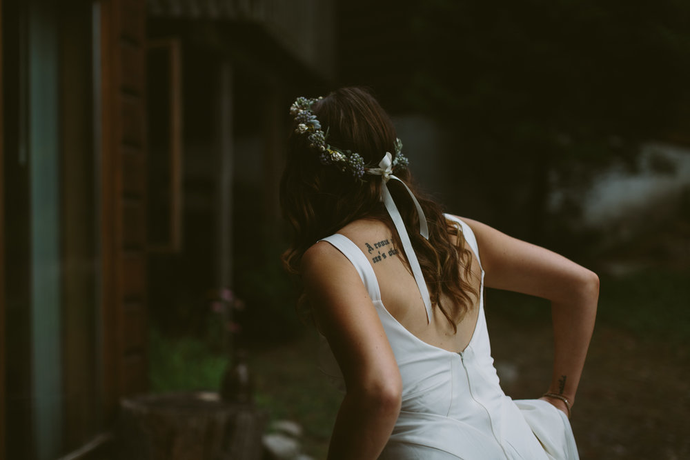 Moody image of bride wearing a floral crown