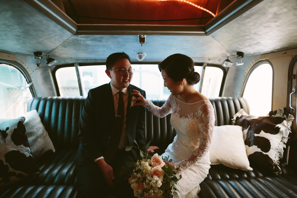 Bride and groom at the back of an airstream