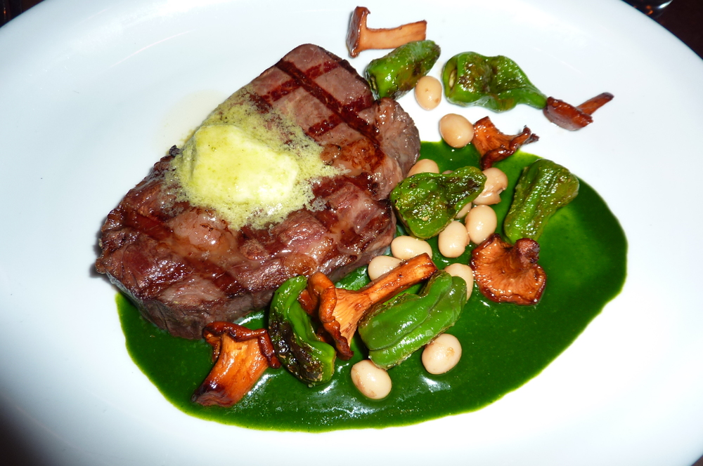 Wasabi butter on steak is amazing.  Wasabi and steak is a perfect pairing.  Think horseradish and prime rib and add an asparagus-like vegetable flavor.  This steak has a wasabi leaf puree below.  Chef: David Padberg.