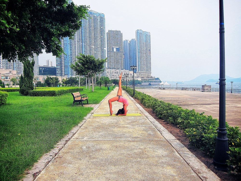 """Shot in Cyberport Waterfront Park where Soultrains serves public """"pay as you wish"""" YogaPOP classes."""