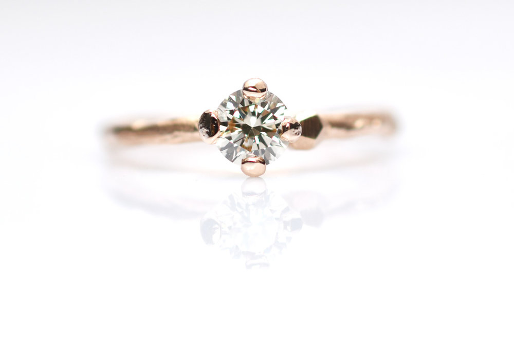 Hand sculpted Miss Twiggy engagement ring in Rose gold with pastel green hued diamond. price €2220