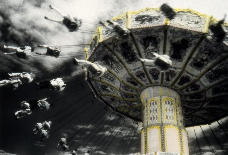SWING RIDE II,    from The Midway  series; infrared hand-tinted b&w print; Limited Edition 10/15.