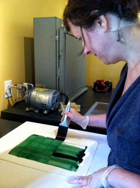Elizabeth above coating a cyan layer
