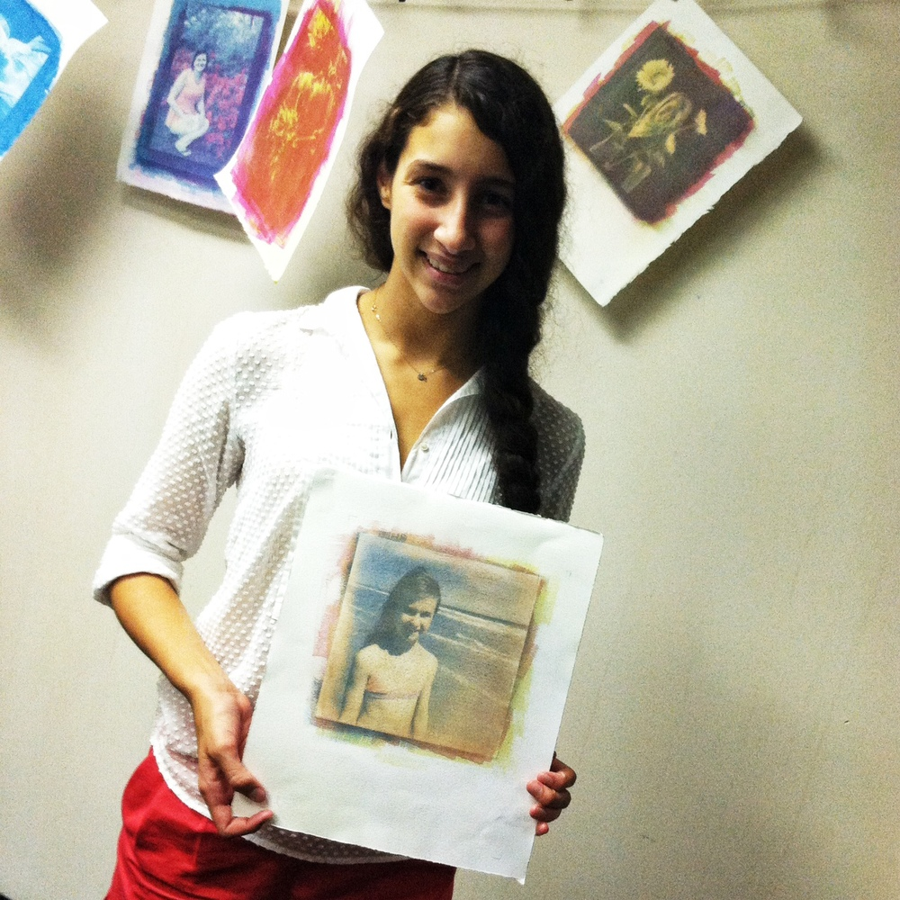 Chloe Mikles with a tri-color gum print she made from a photo of her sister.