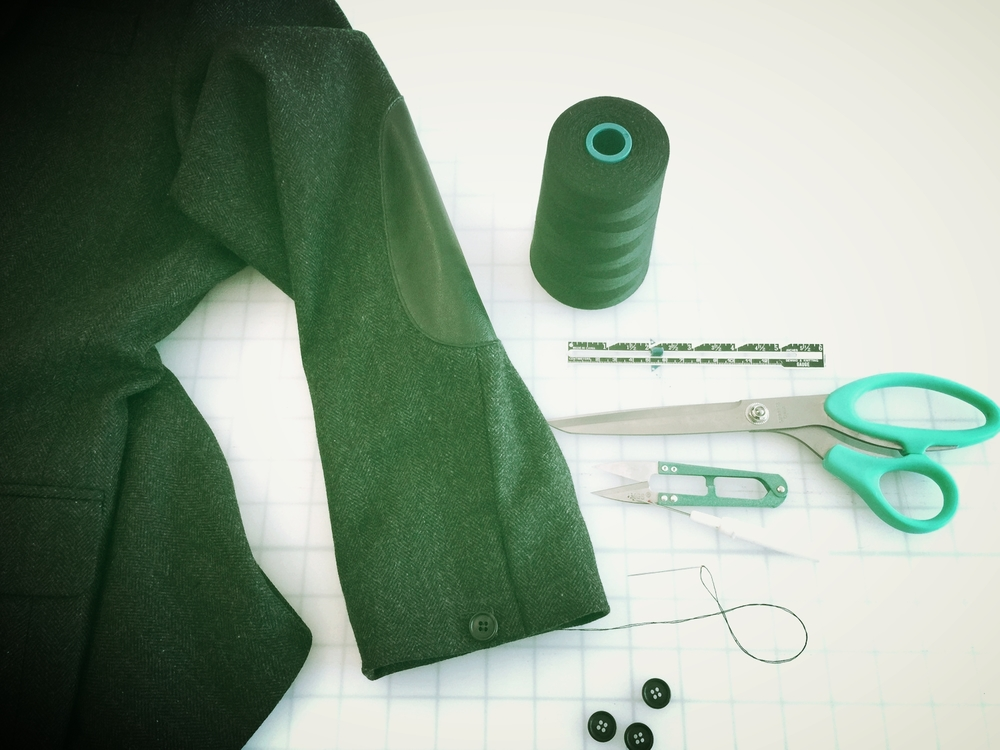 Hemming suit jacket cuffs.