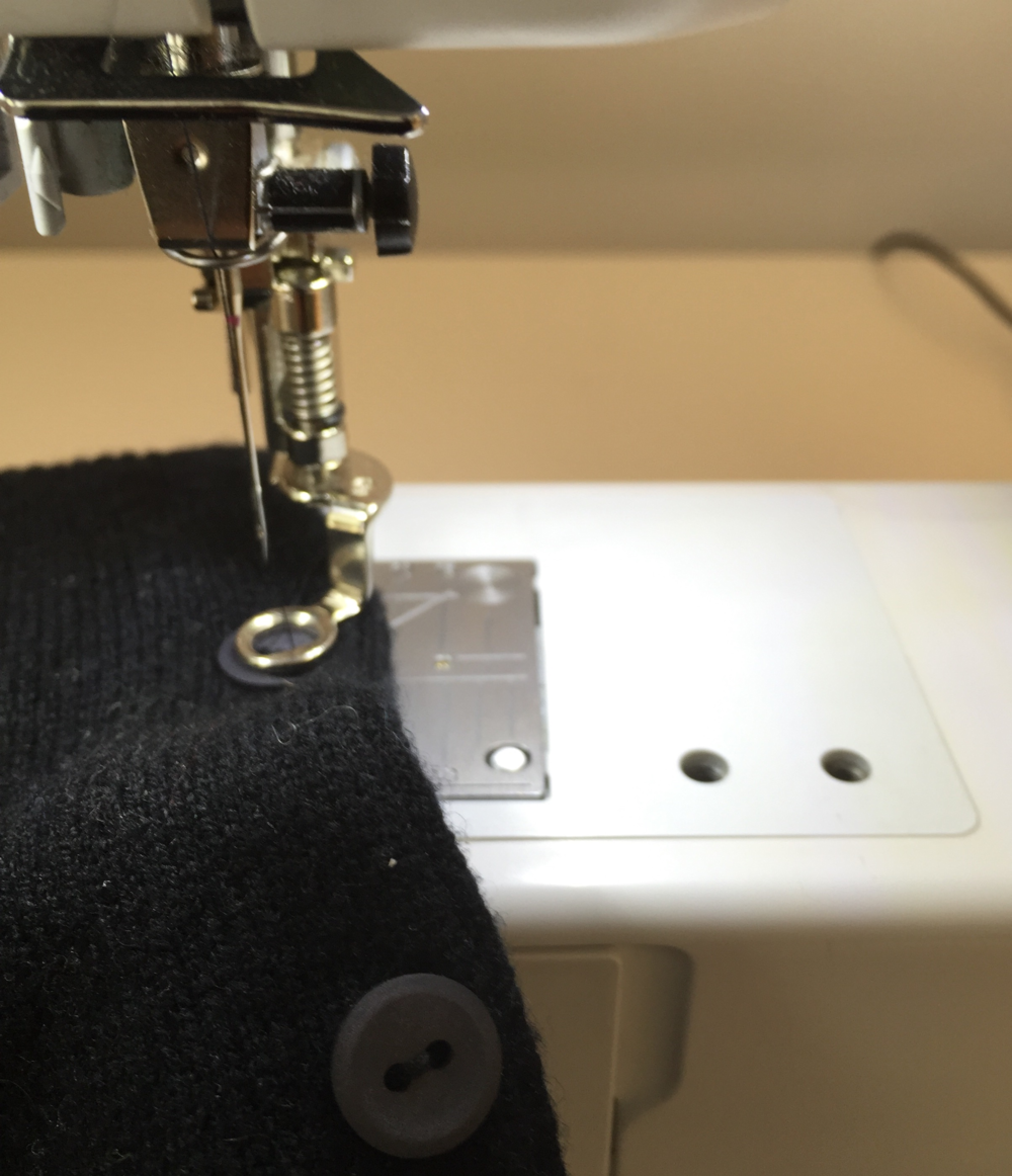 Sewing on buttons with a machine and a darning foot.