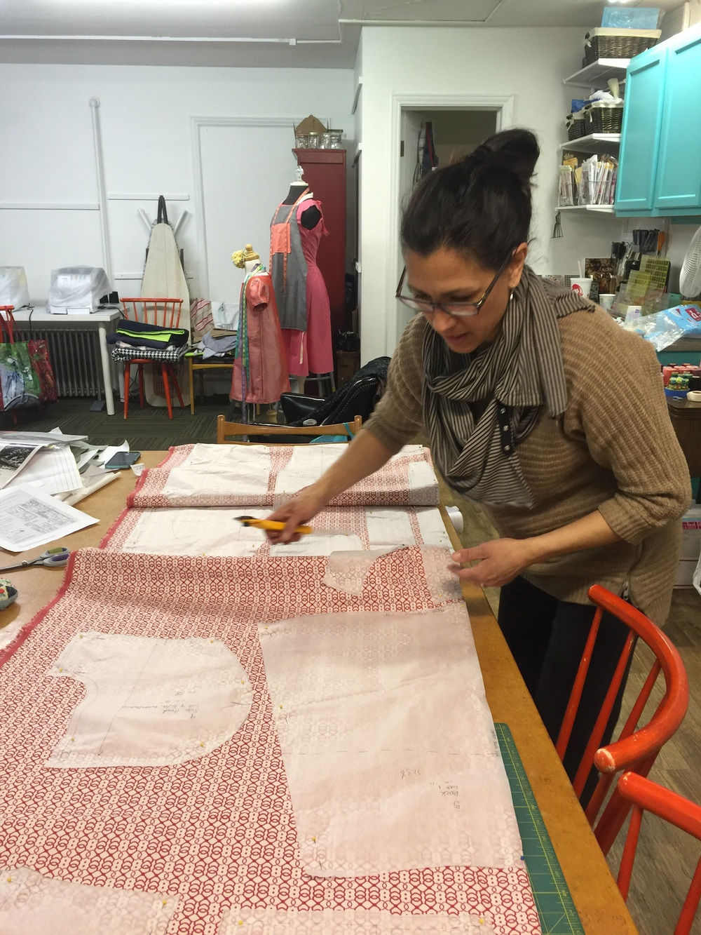 Claudia prepping her pattern pieces. Look at this gorgeous fabric!