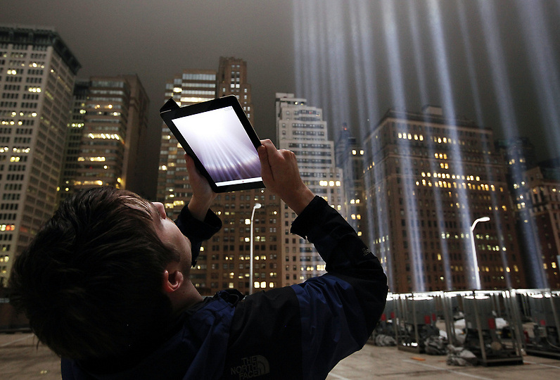 Lighting Designer Frank Hollenkamp uses his iPad to shoot video of the Tribute in Lights ahead of the tenth anniversary of the September 11 terrorist attacks on September 7, 2011 in New York City.