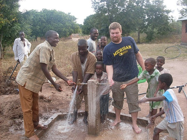 2009 water spraying game… a new experience for the children of Ngelenge