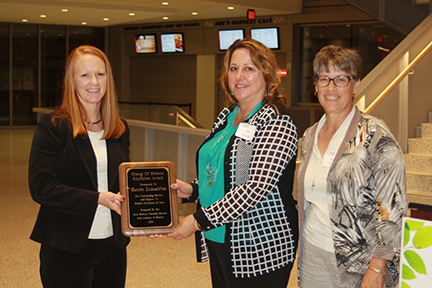 2014 Corporate Friend of Science Award was presented by Kelen Panec, Chair of the Iowa Science Teaching Section. Accepting for KEMIN are Penny Woods (L) and Zita Quade.