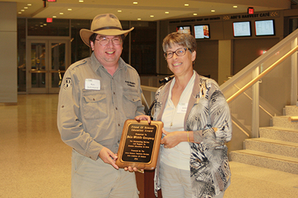 Ron De Armond, CEO, Pella Wildlife Company accepting Corporate Friend of Science Award from Kelen Panec.