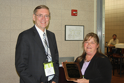 2015 Outstanding Service Award was presented to DeAnna Tibben.