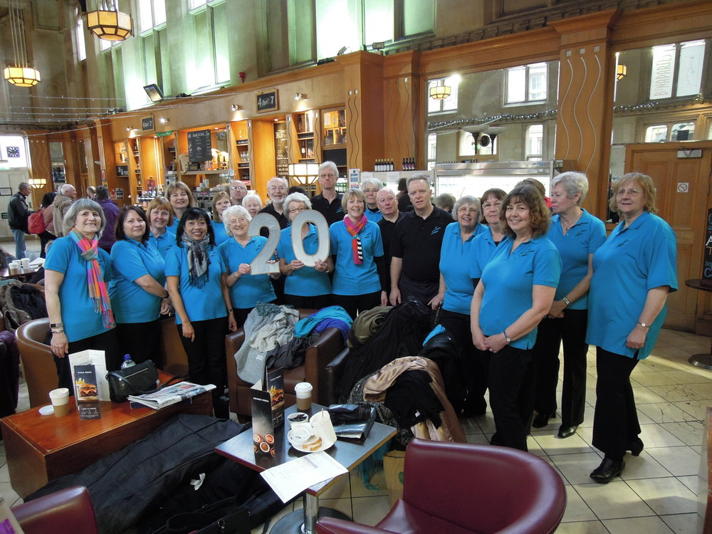 Event 20: After a reviving coffee, we sang in the station cafe!
