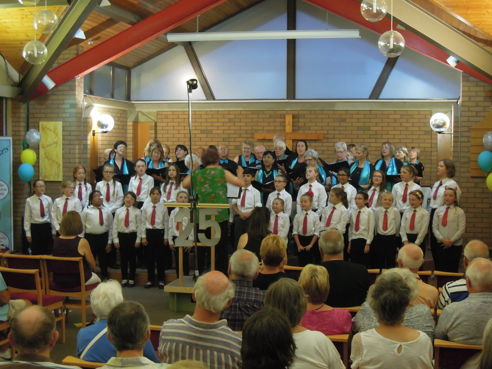 Red Tie Choir and Stokes Singers combine for the Disney Medley conducted by Sian Walters