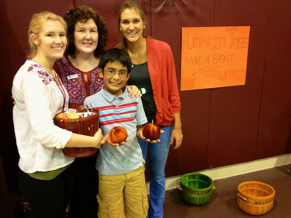 The Shultz family getting ready for their pumpkin toss game at the Mission's Fall Festival.
