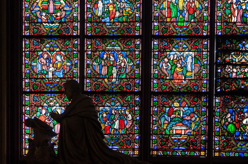 One of the many detailed stained glass windows in Notre Dame