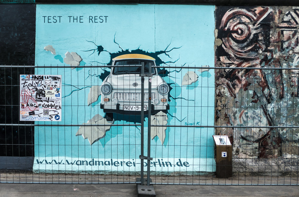 Trabant car crashing through Berlin Wall