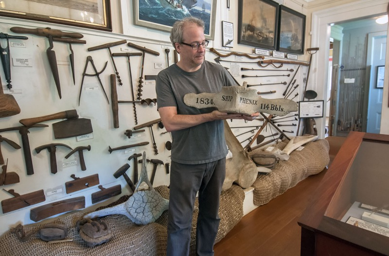 Richard Doctorow shows off a whale vertebra from the 1884 ship Phenix at the Sag Harbor Whaling Museum.  Michael Heller photos