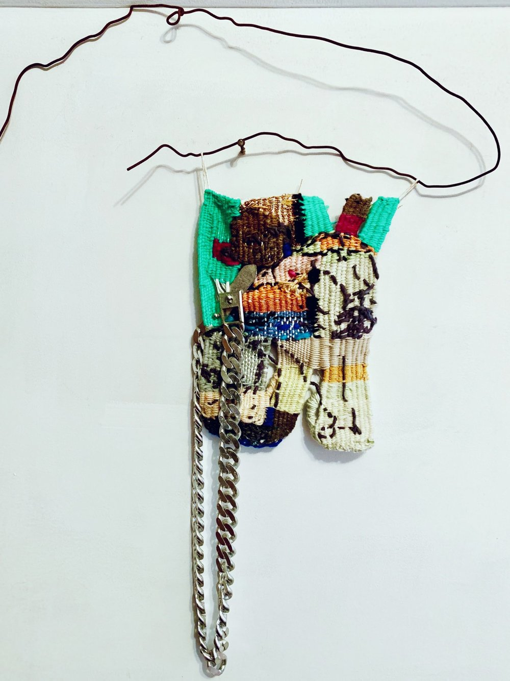 Candace Hill Montgomery (American, born 1945) Migrant Kids Dying & Lock Um Up & All That Wall Space, 2018 Hand spun wool, silk, gold lurex, linen, steel chain Wire (hanger) 12 x 8 inches (without hanger)