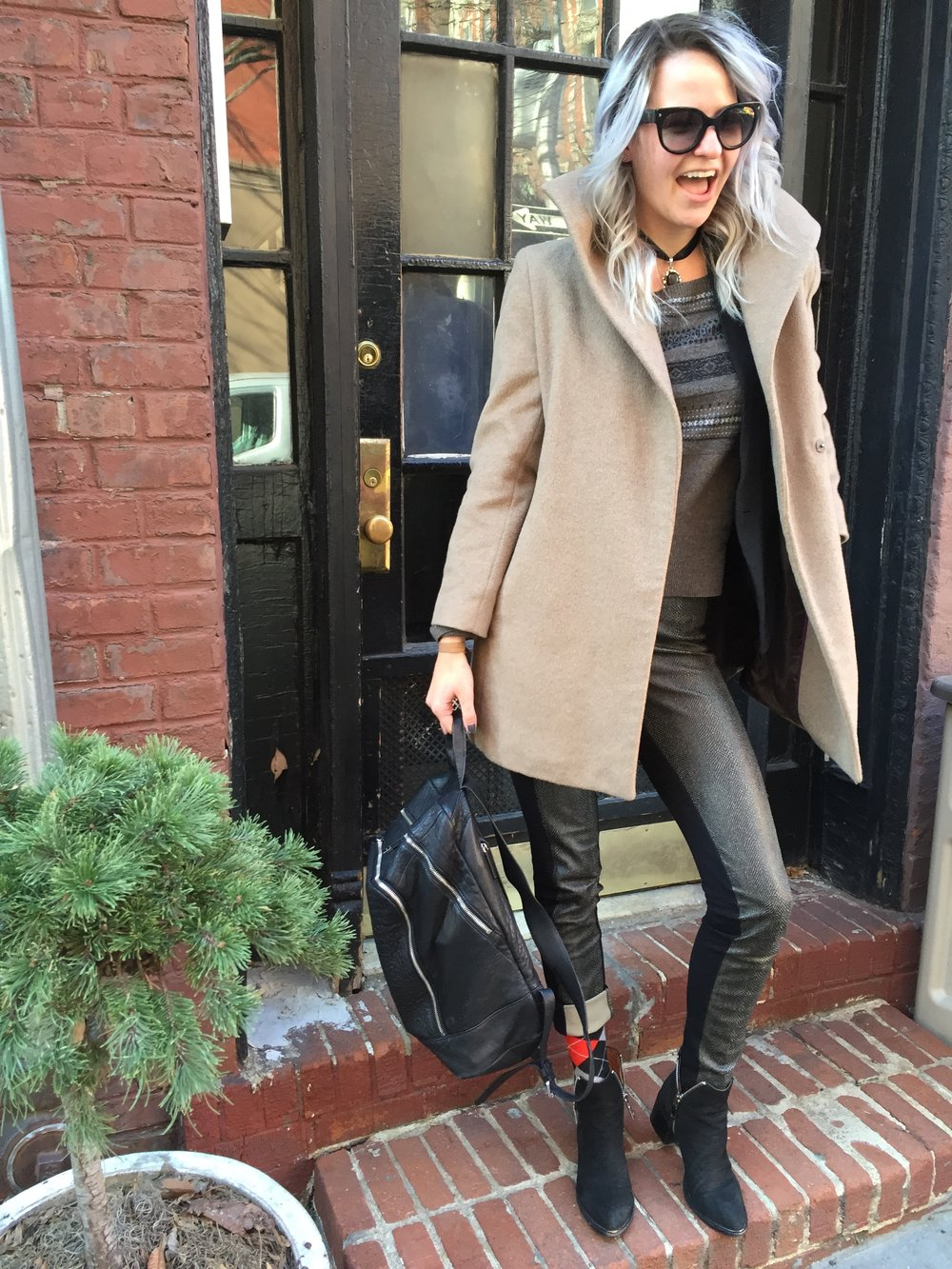 Sunglasses: Prada; Necklace: Stone (Mexico), Coat: Calvin Klein via Goodwill, Legging Pants: BCBG, Sweater: All Saints, Backpack: Vince Camuto, Socks: The Spare Room, Los Angeles, Booties: Jeffrey Campbell Photo Cred: Becca Aguilera, Location: West Village, New York