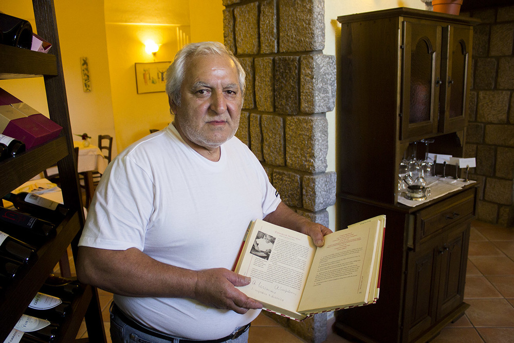 Father showing a article featuring Ristorante Il Borghetto