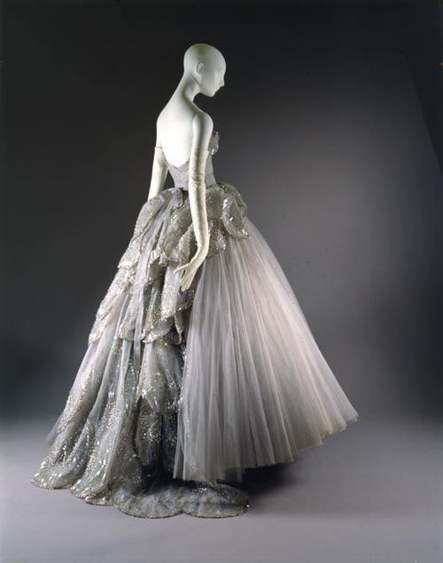 """Venus"" dress, 1949 Christian Dior (French, 1905–1957) Grey silk net embroidered with feather-shaped opalescent sequins, rhinestones, simulated pearls, and paillettes"