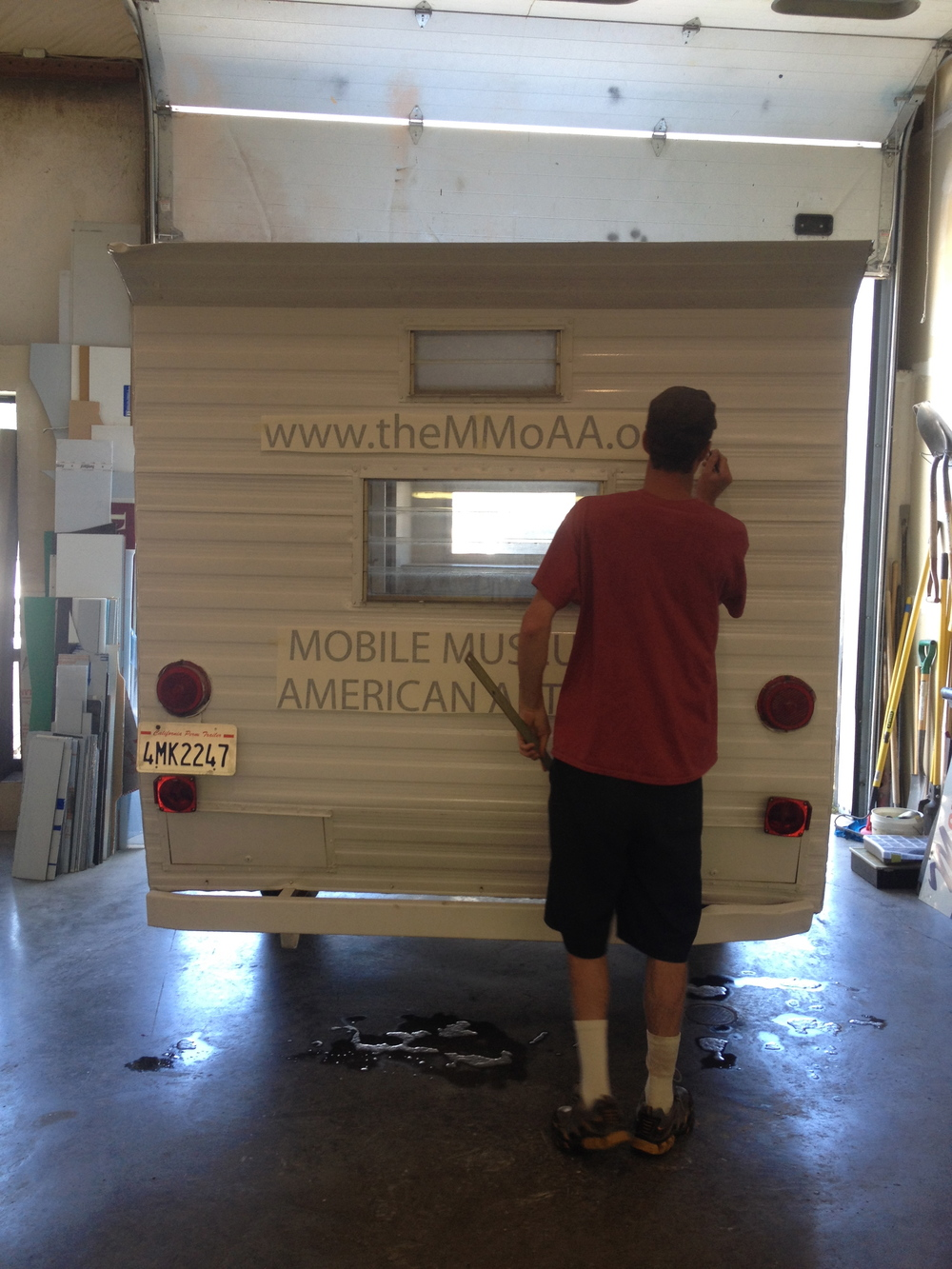 Artist and graphic designer Matt installs vinyl lettering on MMoAA at Xtreme Graphics in Alamosa, Colorado.