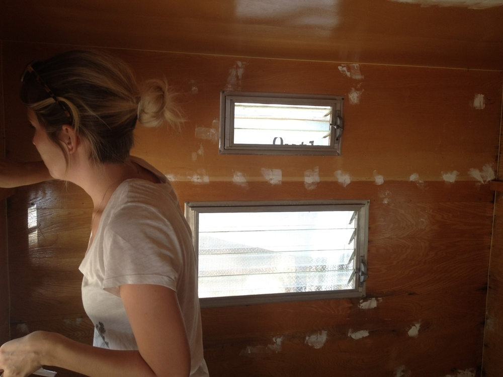 Chelsea patches up the interior of the trailer.