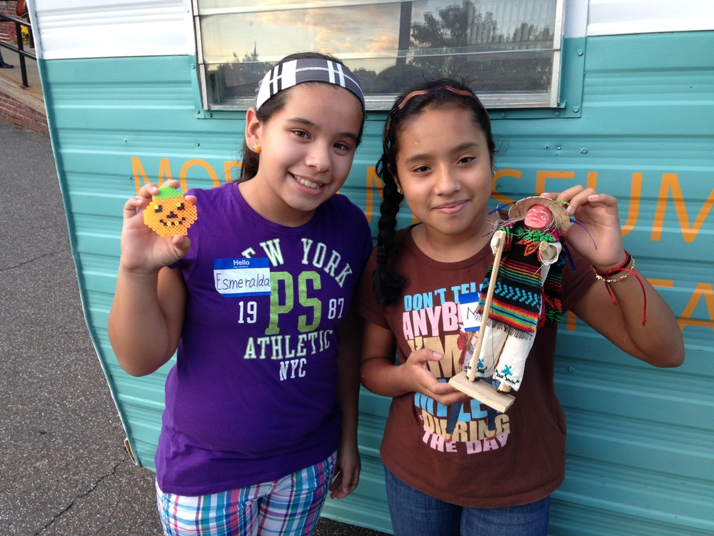 Esmerelda and Melanie bring artifacts that represent their Mexican heritage to the MMoAA museum and storytelling workshop.