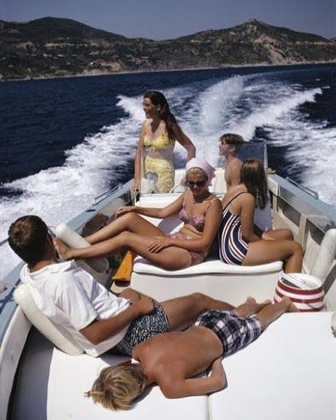 The Pucci Family on a motorboat off the Italian coast, August 1969 by #SlimAarons | Tag your escapes at @74escape and #74escape for features!