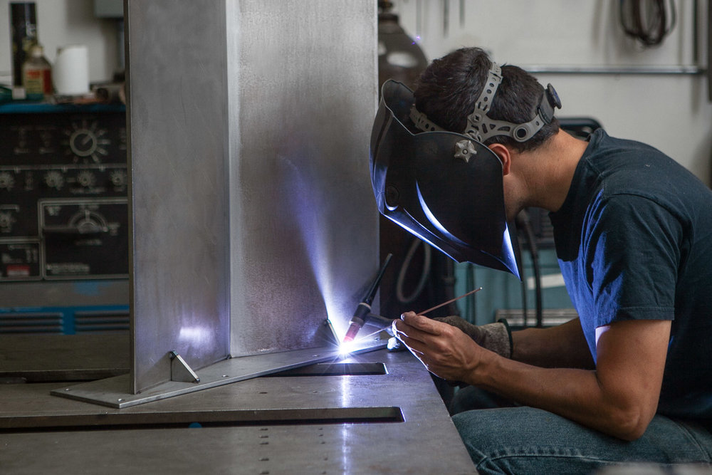 Base fabrication is done in house and custom fitted to each tabletop. Each base is TIG welded, a time consuming and precise welding technique, to ensure a solid foundation for each piece.