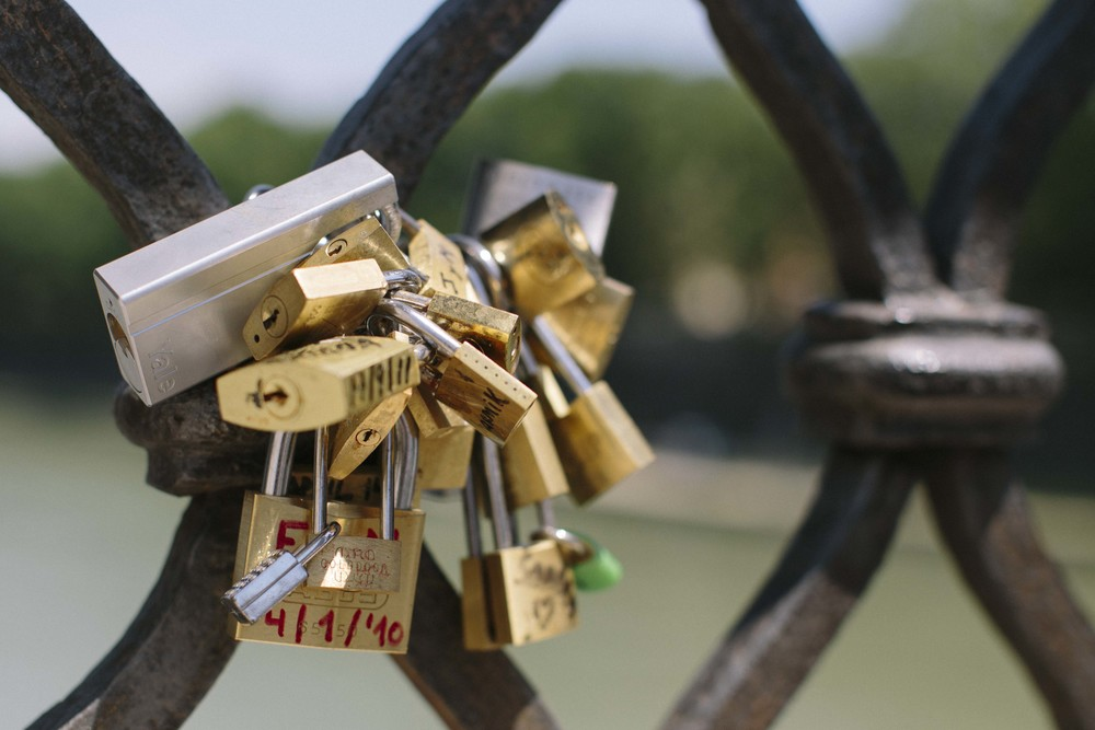"Couples attach a lock to the ironwork on the bridges and toss the key into the river to symbolize ""unbreakable love."""