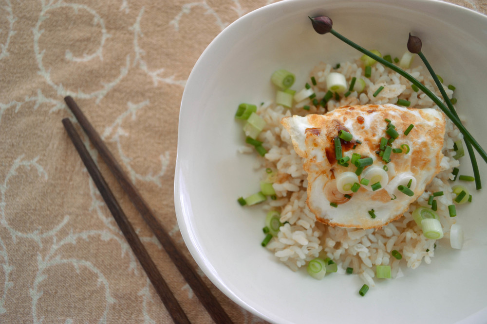 Coin Purse Egg on Haiga Rice Topped with Scallions, Chives and A Dash of Tamari