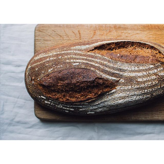 "Bread = Love. I said this to my neighbors Paul and Becky after they thanked me for giving them a loaf of Red White and Rye the other day. ""Well then, we love you!"" was their response. But seriously, what if we were to share beautiful, nutritious food made by our own hands with those around us? For no reason other than because we wanted to? Wouldn't the world be a better place? I think so. #foodblogger #bread #pnwspring #f52grams #bread🍞 #breadbaking #baking #grain #gratitude #food #foodphotography"