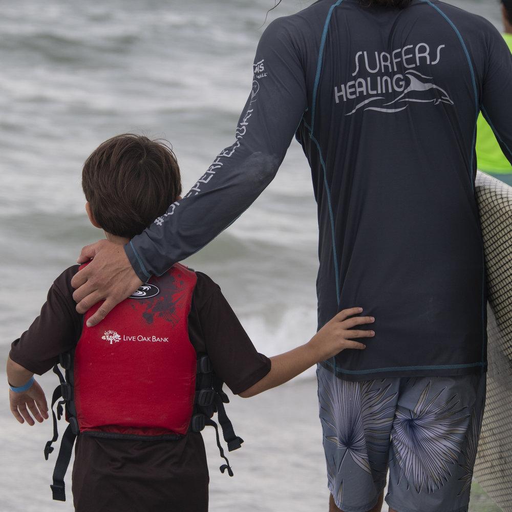 ILM_SurfersHealing_Surfing_goingout_8192018.jpg