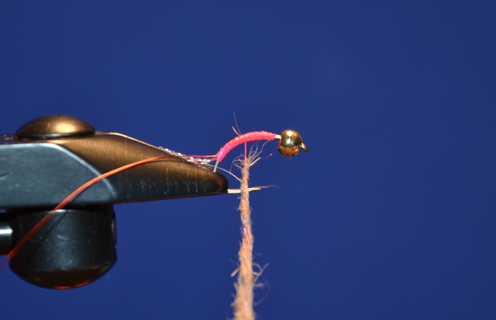 Tie in the red wire and dub the body with the combination of hare's ear and Ice dub uv Cinnamon.
