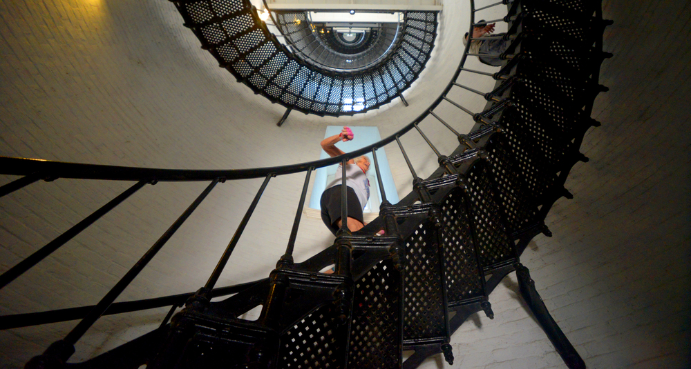 ALEX.SANCHEZ@STAUGUSTINE.COM Nanci Robinson begins her climb up the 219 steps of the St. Augustine Lighthouse on August 1, 2014
