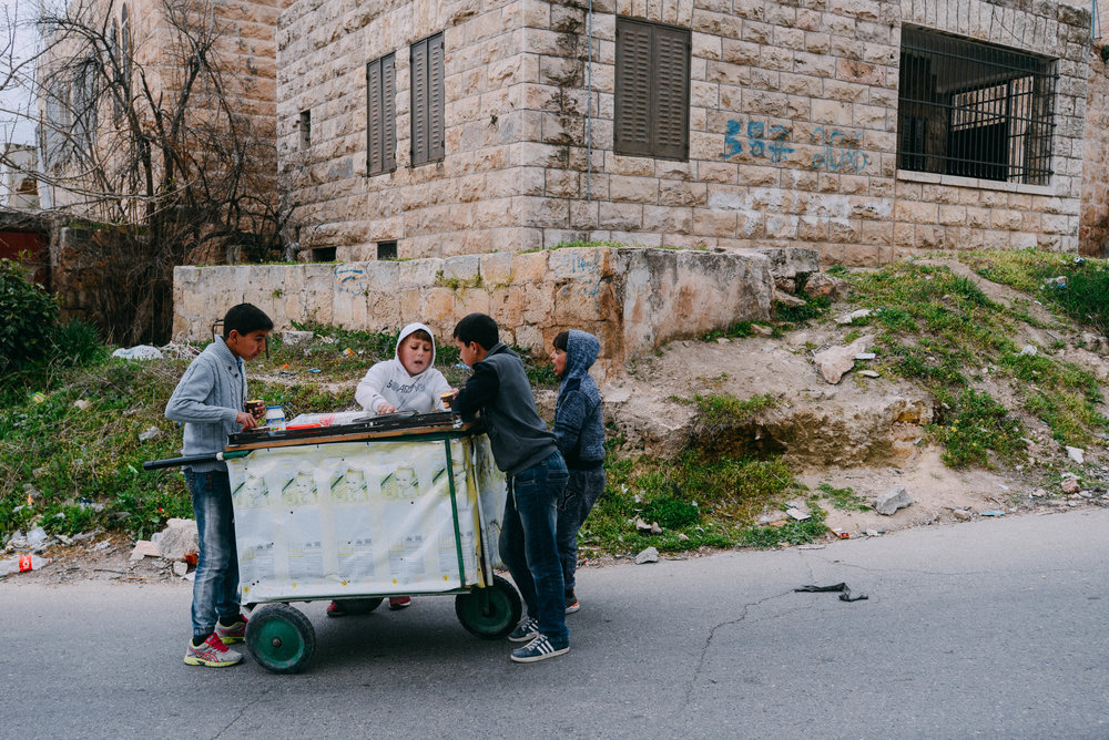 Boys selling food in Hebron, Palestine.