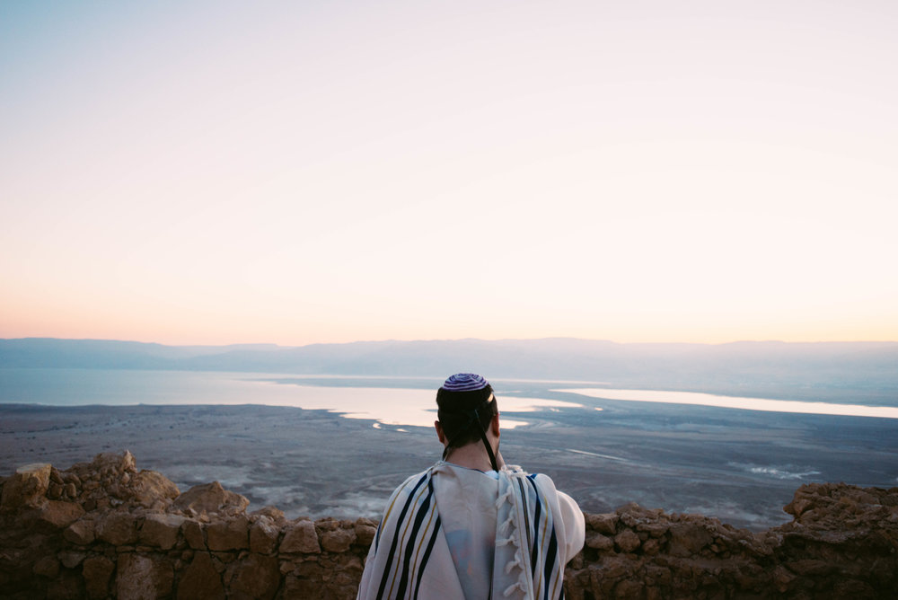 A man prays atop Masada, an ancient fortification in the   Southern District   of Israel. It is located on the eastern edge of the Judaean Desert, overlooking the Dead Sea.