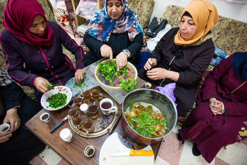 Palestinian women prepare lunch for tourists in the Women in Hebron cooperative in Idna, a city near Hebron.