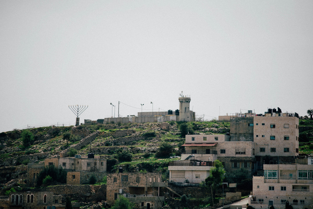 The occupied zones of the West Bank hold settlements where many Orthodox and Hasidic Jewish people relocate to.  The occupied zones, H2, allow for settlers to have their homes on the tops of the hills over looking the Palestinian sectors- a strategic move made by the IDF in case of uprisings and clashes.