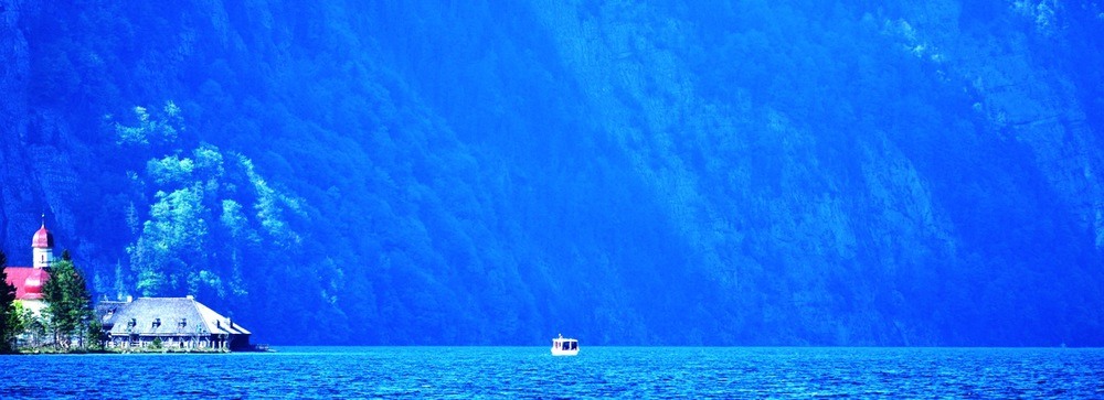 Speck in the Big Blue. Koenigssee. Bavaria. Germany.