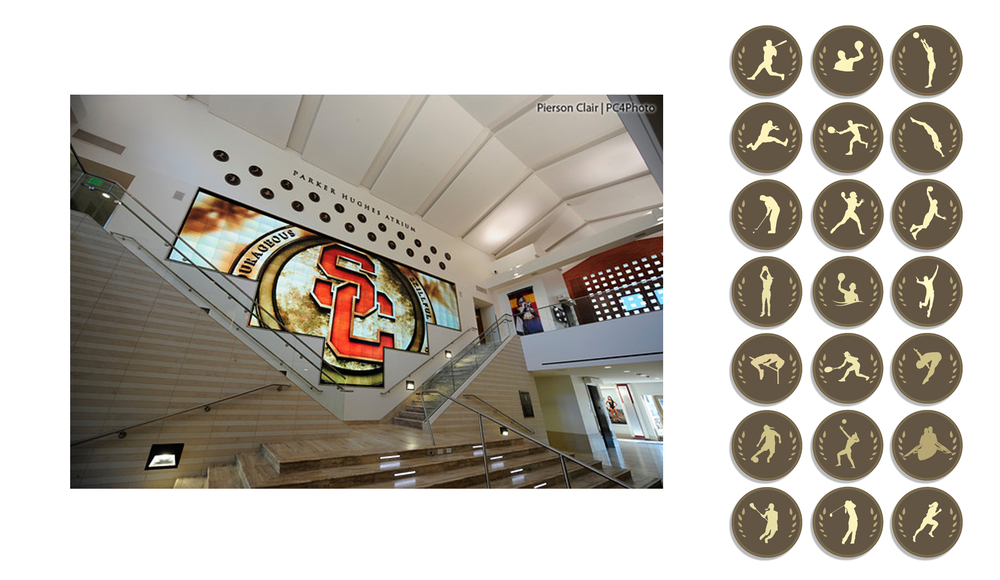 Photo by Pierson Clair | John McKay Center Installation image: Parker Hughes Atrium 21 sports medallion designs