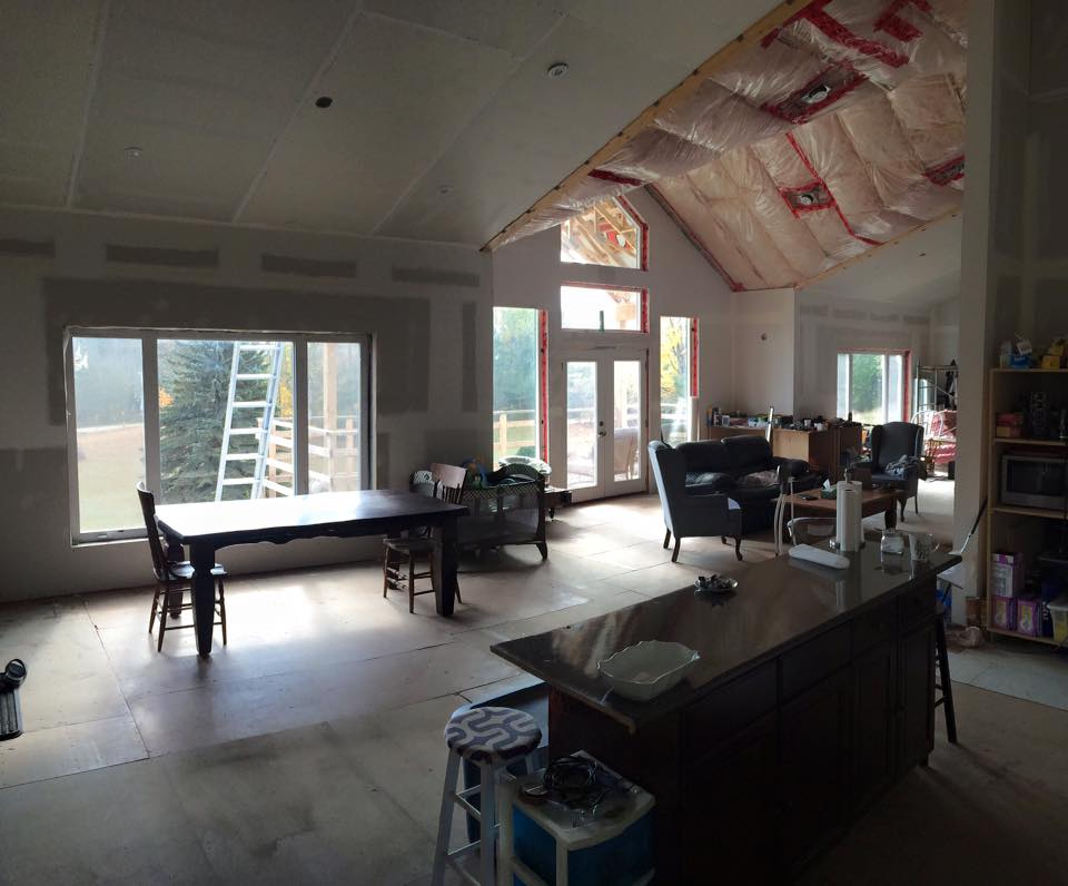 The kitchen, dining and living room are all open to each other. The ceiling above the living room has no drywall since we plan on doing a wood feature in that area.