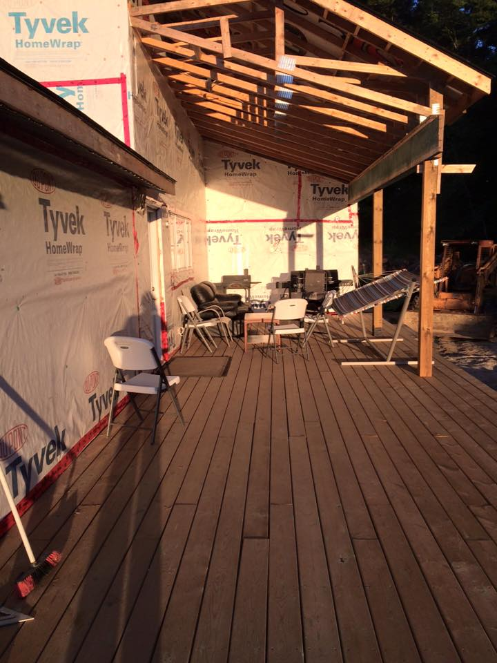 Here you can see the kitchen door on the long wall. The short wall is where the TV will hang. The extended part of the deck will go from that first post all the way to the wall and out towards the forest. New outdoor furniture is needed in this spot!