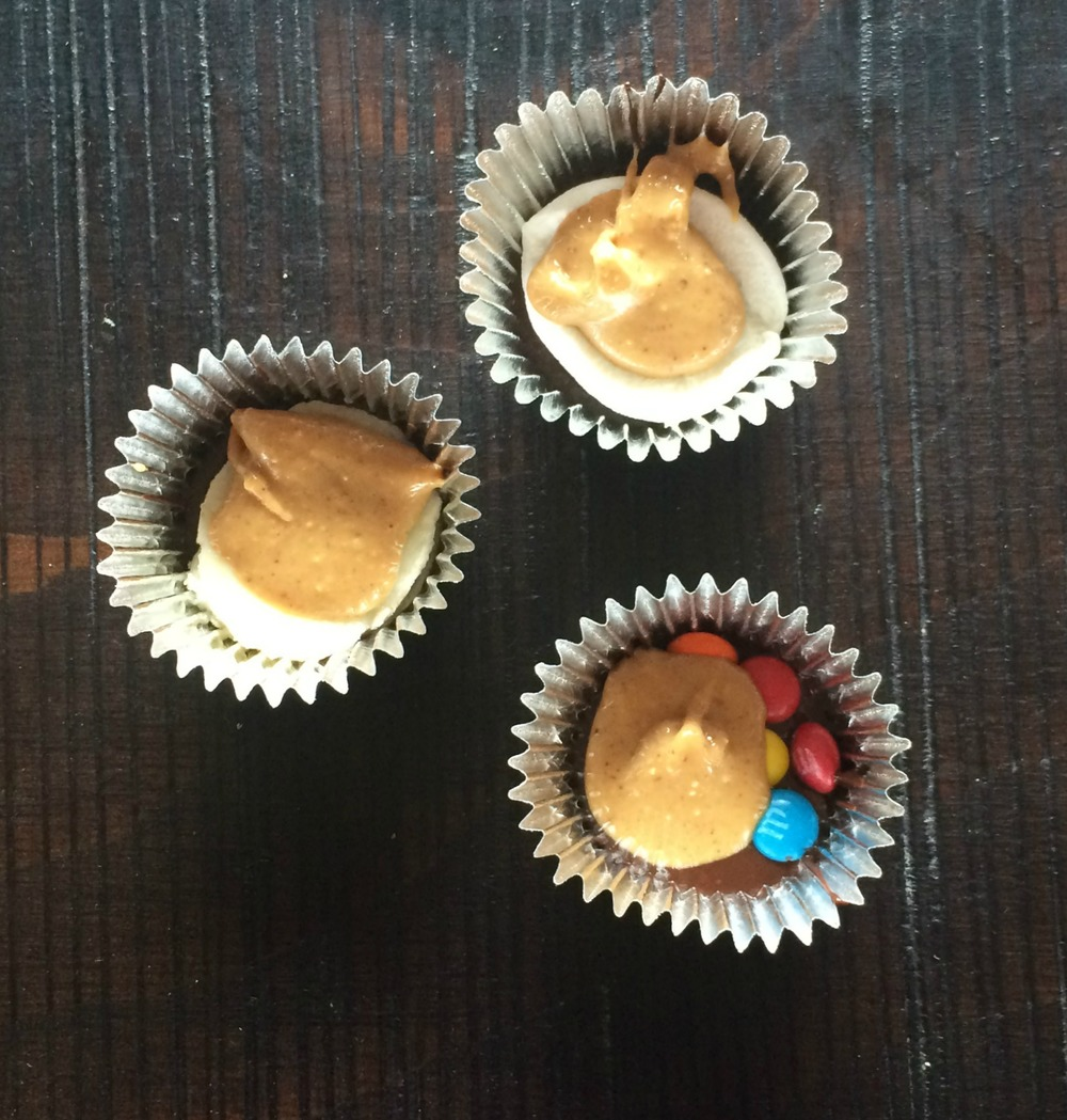Drop a dollop of peanut butter on top of each one.