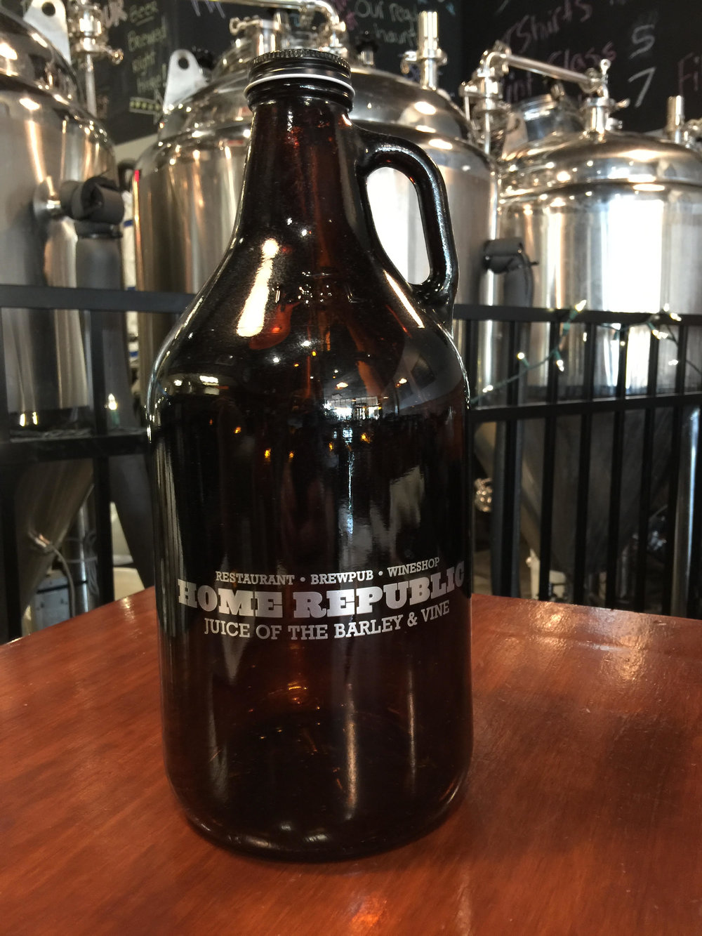 64 oz amber growler in silver. $7 + Shipping