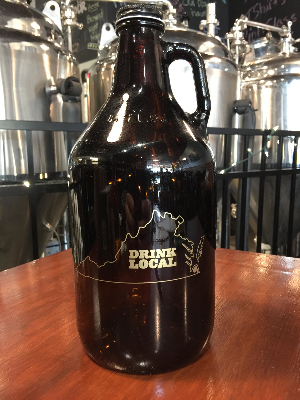 64 oz amber growler in gold. $7 + Shipping