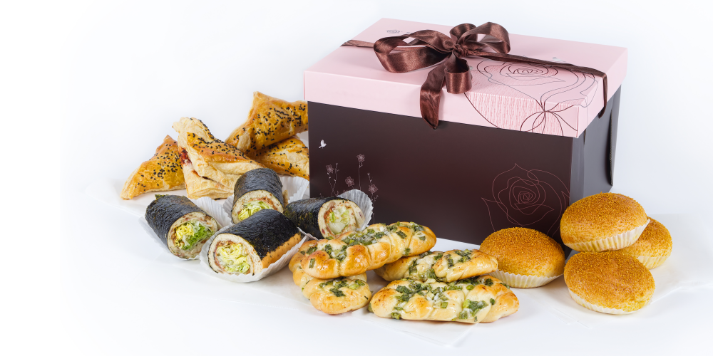 Our Savory Platter. Pictured above (left to right): BBQ Pork Puff, Seaweed Bacon Roll, Spring Onion Bun, Curry Chicken Bun