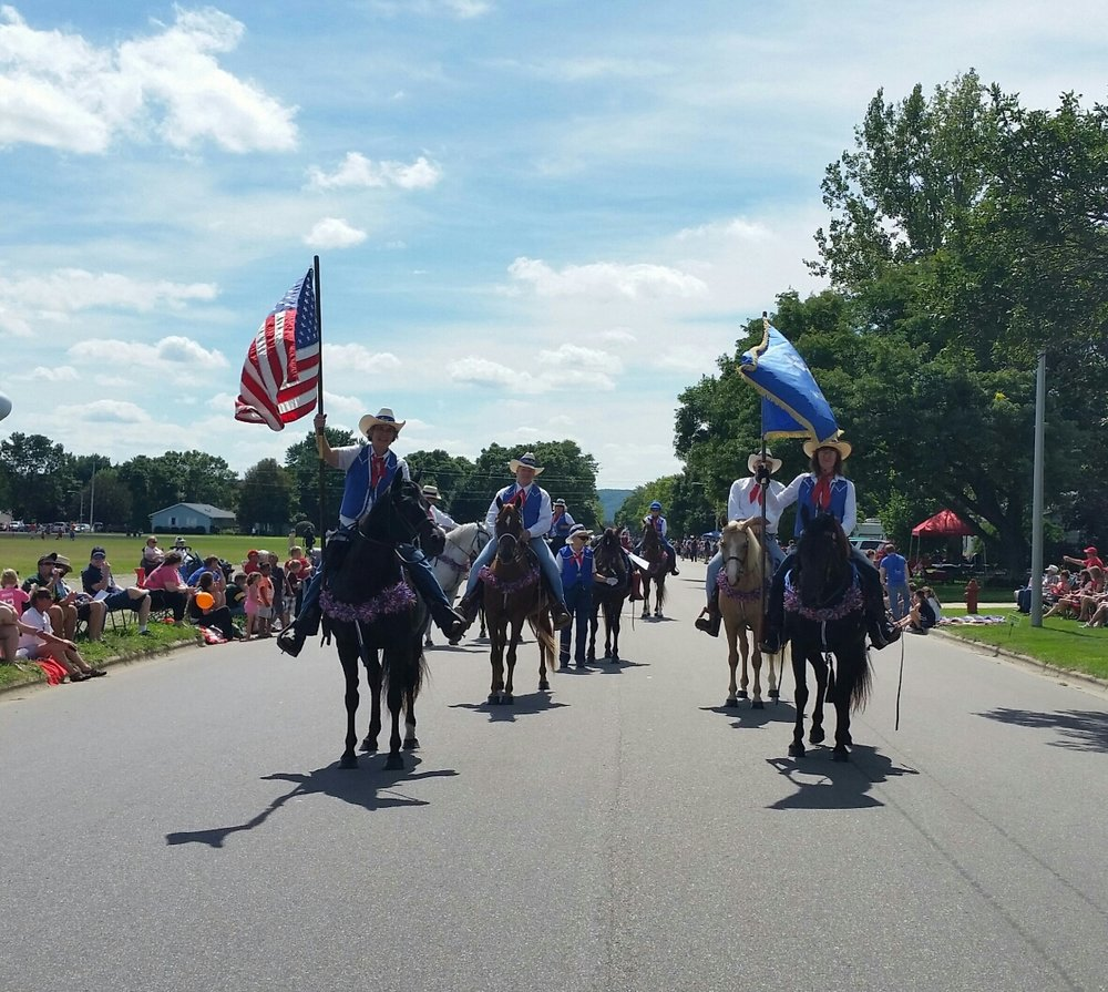 Darcy Overturf and Katz Jackson lead the Wisconsin Morgan Horse Club parade unit in the Tournament of Chips Parade.